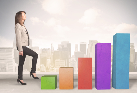 business trends: Business person climbing up on colourful chart pillars concept on city background