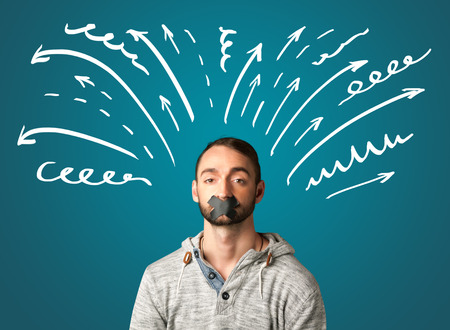 dismay: Young man with taped mouth and white drawn lines and arrows around his head
