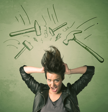 headache: Tired woman with hair style and headache hammer symbols concept on background Stock Photo