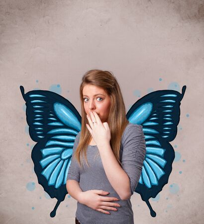 Cute young girl with butterfly blue illustration on the back photo
