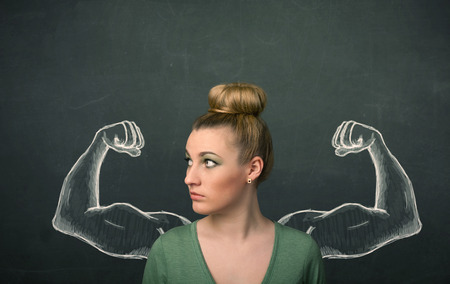 strong women: Pretty young woman with sketched strong and muscled arms