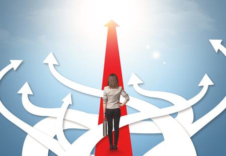 confused: Concept of confused businesswoman with different direction arrows Stock Photo