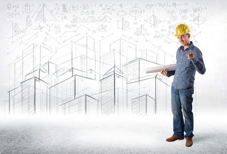 construction project: Handsome construction specialist with city drawing in background concept Stock Photo