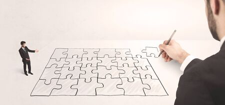 solution: Business man looking at hand drawing solution, puzzle solution concept