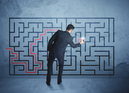 business plan: Businessman finding the solution of a maze Stock Photo