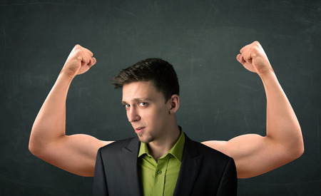 gesticulation: Young businessman wondering with strong and muscled arms concept
