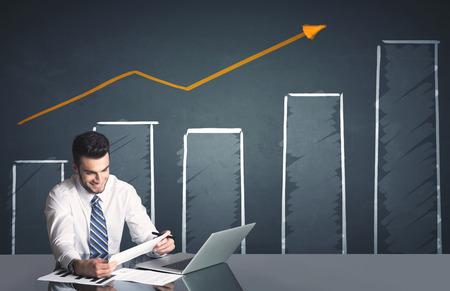 Sikeres üzletember, üzleti diagram a háttérben