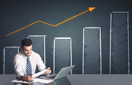 success business: Successful businessman with business diagram in background