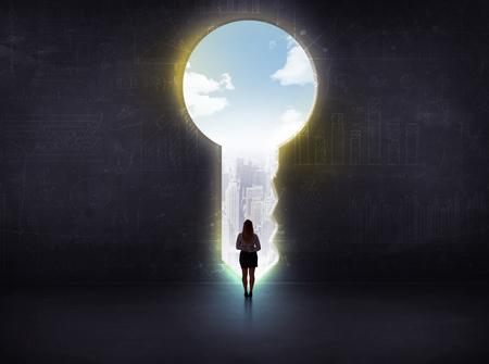 challenge: businessman looking a big key, solution concept