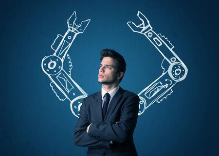 robot: Hombre de negocios con el concepto brazos rob�ticos Foto de archivo