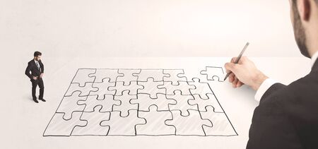 the solution: Business man looking at hand drawing solution, puzzle solution concept