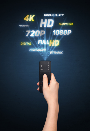 changing channel: Hand holding a remote control, multimedia properties coming out of it