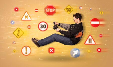 chofer: Conductor joven con las señales de tráfico le concepto alrededor Foto de archivo