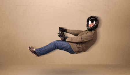 levitate: Happy funny man driving a flying car concept on background Stock Photo