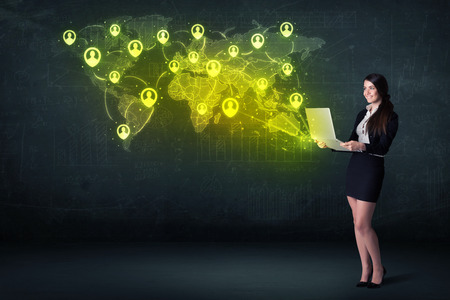 young add: Businesswoman in office with laptop and social network world map concept on background