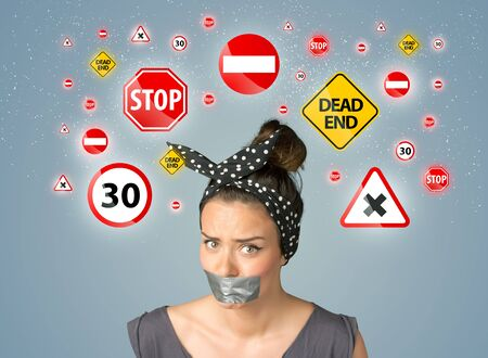 sellotape: Young woman with taped mouth and traffic signals around her head