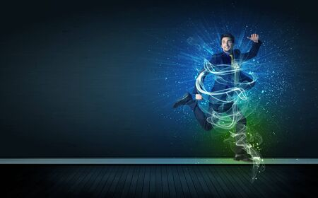 businessman jumping: Talented cheerful businessman jumping with glowing energy lines on background Stock Photo