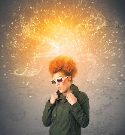 energetic: Young woman with energetic exploding red hair concept on background