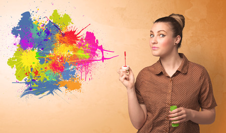 blow: Cute girl blowing bubble spalsh graffiti into wall Stock Photo