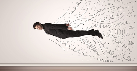 comming: Business man flying with hand drawn lines comming out concept Stock Photo