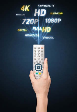 quality controller: Hand holding a remote control, multimedia properties coming out of it