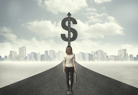 direction sign: Business woman on road heading toward a dollar sign concept