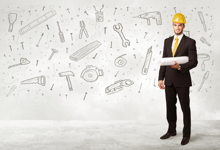 planing: Construction worker planing with hand drawn tool icons on background