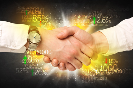 blow: Business Handshake with number analysis Stock Photo