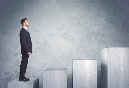 career development: Business person stepping up a staircase