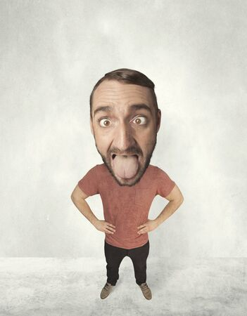 exaggeration: Funny person with big head makes jesting facial expression Stock Photo