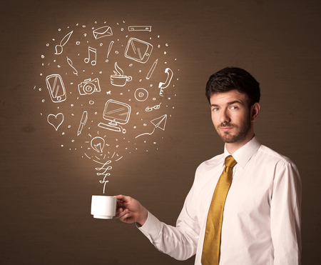 espresso cup: Businessman standing and holding a white cup with drown social media icons coming out of the cup