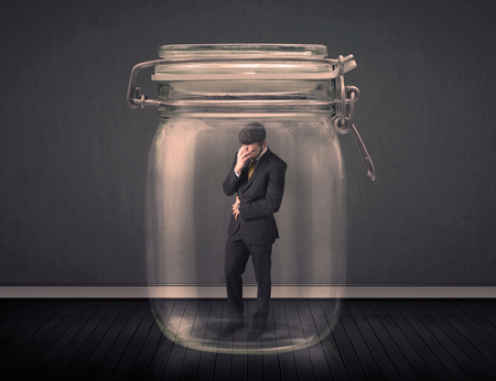close up food: Businessman trapped into a glass jar concept on background