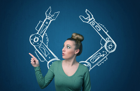 thinking machines: Pretty young woman with robotic arms concept Stock Photo