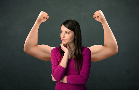 strong women: Pretty young woman with strong and muscled arms concept