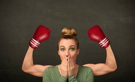 muscled: Pretty young woman with strong and muscled boxer arms concept