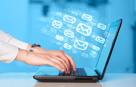 spam mail: Concept of sending e-mails from your computer Stock Photo