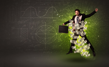 winner man: Cheerful businesman jumping with dollar banknotes around him on background