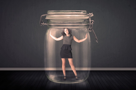 trapped: Businesswoman trapped into a glass jar concept on background Stock Photo