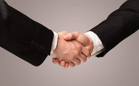 fondo degradado: Business handshake on gradient background
