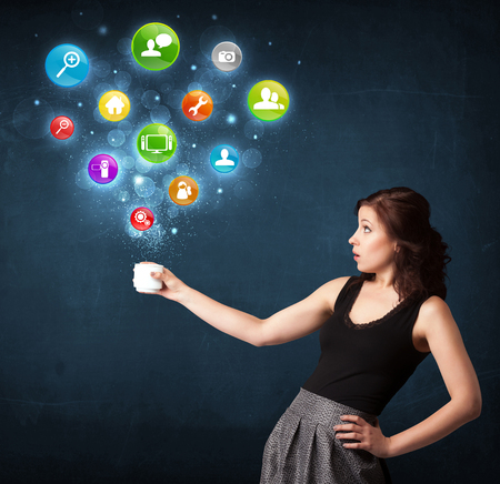 creative force: Businesswoman standing and holding a white cup with colorful setting icons coming out of the cup