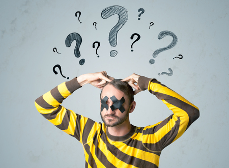 dismay: Young man with taped eye question mark symbols around his head
