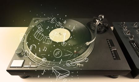 audiophile: Turntable playing classical music with icon drawn instruments concept on background Stock Photo