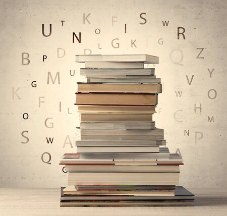 reading books: Books with flying letters on vintage old background Stock Photo