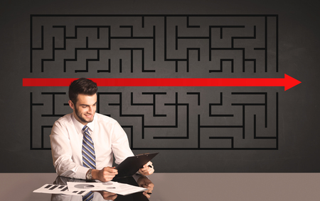complicated journey: Successful businessman with a solved puzzle in background