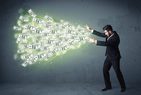 financial advisors: Business person throwing a lot of dollar bills concept on background