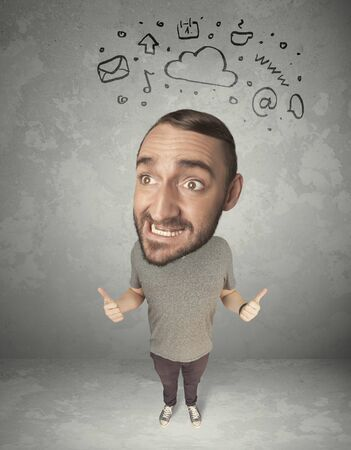 big head: Funny guy with big head and drawn social media marks over it Stock Photo