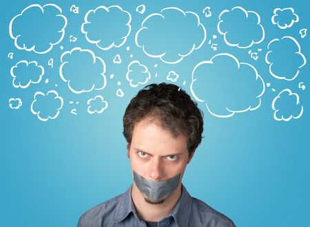 keep an eye on: Funny person with taped mouth and hand drawn clouds around head Stock Photo