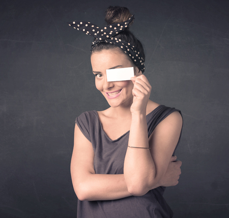 blank space: Pretty girl holding blank copy space paper at her eyes concept