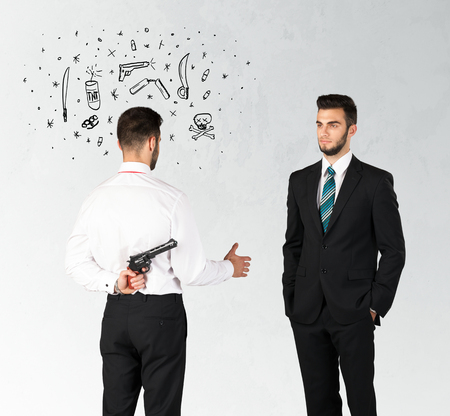 ruthless: Ruthless businessman handshake with hiding a weapon and weapon symbols around his head