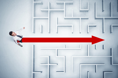 problems solutions: Business man looking at maze with red arrow showing the path